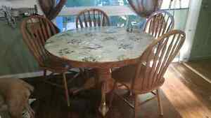 Oak dining table with insert and 5 chairs