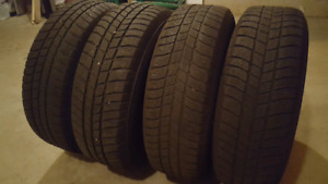 215 70 R16  100T Polaris winter Tires on rims 450$