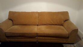Four seater sofa caramel