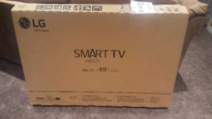 "*Never before used* 49"" LG smart tv"