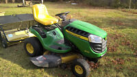 Great John Deer Model D125 tractor with sweeper and trailer