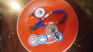 Oilers set. Earings, two keychain accessories
