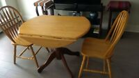 Round, wood, leaf style table with 2 matching chairs