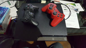 PS3 Slim. 2 controllers, and games