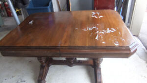 solid wood dining table in need of refinish on top
