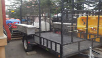 Landscape trailer with locking tool boxes