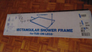 Rectangular shower frame for tub-on-legs.