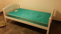 Single white twin bed