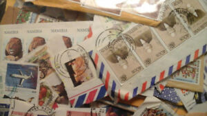 STAMPS COLLECTION OVER 1000 INTERNATIONAL STAMPS