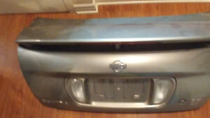 Nissan trunk lid with spoiler