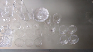 Crystal vases, glasses, desert plates, cream and sugar, decanter