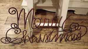 Wrought iron merry Christmas sign