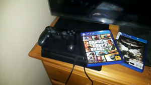 PlayStation 4 slim...... 1 tb and games