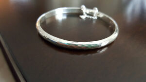 Charm Jewellers 925 Silver Bangle with safety catch.
