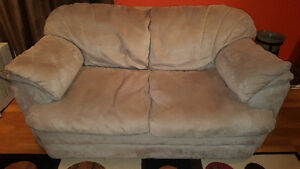 Creme/beige micro suede loveseat