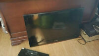 Samsung flat screen tv and stand