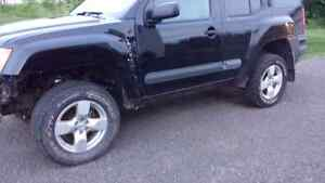 """17"""" rims and tires off 2005 Nissan Xterra SE"""