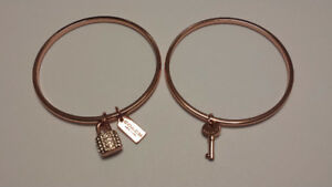 Coach Set of 2 Key and Lock Gold Tone Bangles