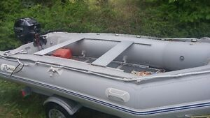 13 FT INFLATABLE BOAT ,20 HP TOHATSU MOTOR  AND TRAILER