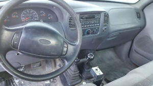 2000 Ford F-150 Pickup Truck with Plow