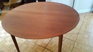 Midcentury Teak Round Dining table with built in extension leaf