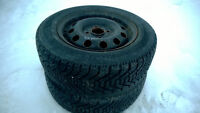 two winter tires GOOD YEAR NORDIC, ON RIMS off ford focus 2002,