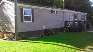 2 bedroom home with 3 1/2 acres priced to sell