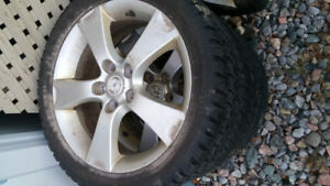 Set of four 17 inche snow tires off Mazda with factory rims