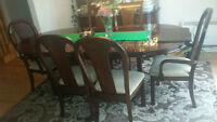 italian dinning table set with 6 chairs and dishware