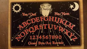 1990's Ouija Board complete with instructions.
