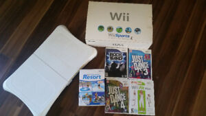 Wii in original box with Wii Sports and Wii fit
