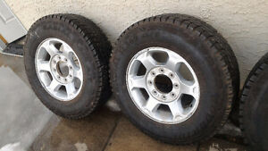 Ford F250 Rims with Tire 80% left.