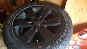 FORD STOCK TIRES WITH BLACK RIMS