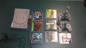 Playstation 1 with 7 Games & 2 Controllers