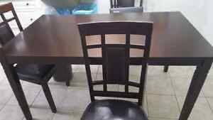 Dark brown wood table and chairs