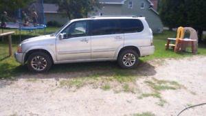 05 7 passenger 4x4 suzuki need gone