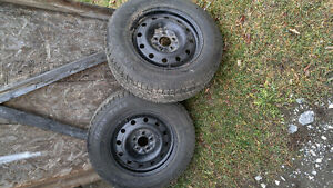 2 Iron Man Polar Trax Snow Tires on Rims
