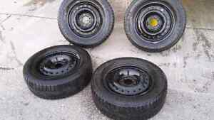 Set of  4 michelin xice tires with rims for sale