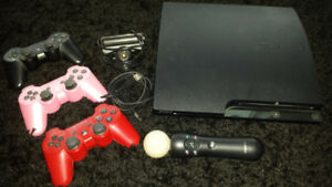 PlayStation 3 with games and remotes with PlayStation 2