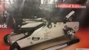 new in box, never opened, chrome plated 2.5 ton car jack