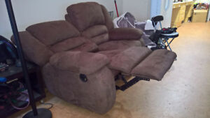Chocolate colored reclining loveseat