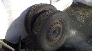 Two winter tires mounted on 2 steel rims. in good condition