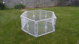 Large baby gate or fence.