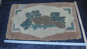 Antique beaver hooked rug with maple leaves and log