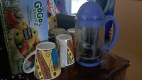 French Coffee Press(tupperware) with some extra mugs.