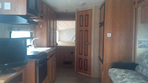 Jayco 23 foot hybrid travel trailer from RENT with queen beds