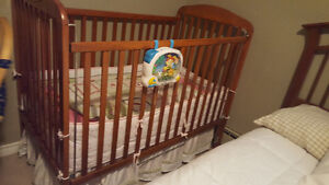 Wooden crib with mattress