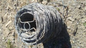 NEVER USED:  Full role of barb wire fencing.  Price is, $80.