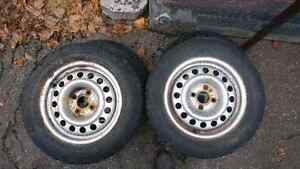 "4 Used Artic Claw Snow Tires For Sale On 14"" Rims"