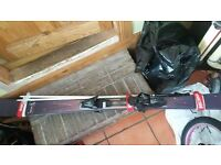 BARGAIN !! ** WOMENS HIGH QUALITY SALOMON LAVA SKIS WITH POLES AND HEAD BOOTS **